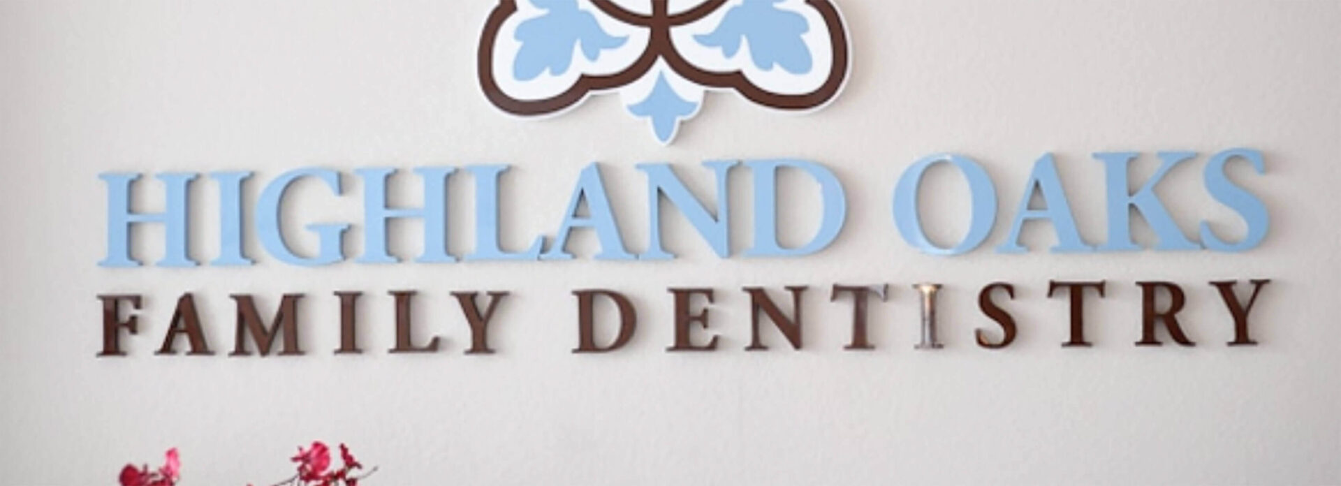 Highland Oaks Family Dentistry interior office logo