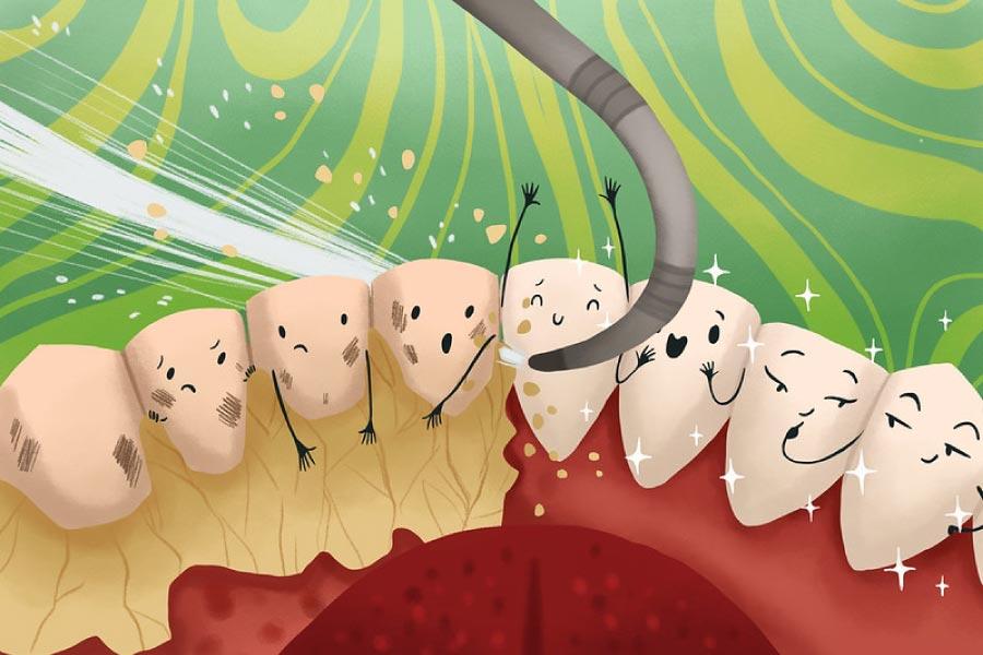 Cartoon of happy teeth getting a professional dental cleaning.